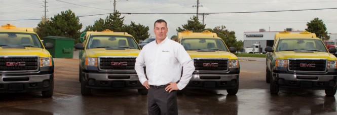 cropped-7291-mike-in-front-of-trucks1.jpg